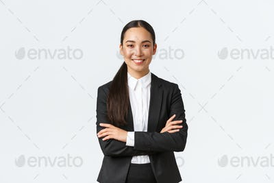 Successful young asian businesswoman in suit ready do business, cross arms confident and smiling