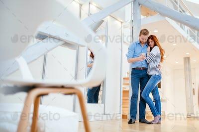 Couple enjoying their modern new apartment