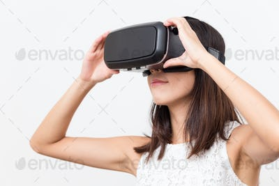 Asian Woman watching with virtual reality