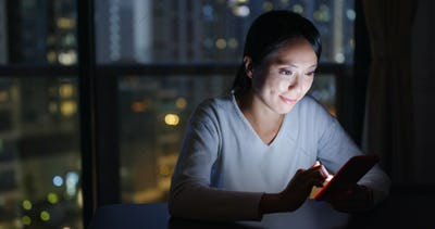 Woman use of smart phone and feeling tired in the evening