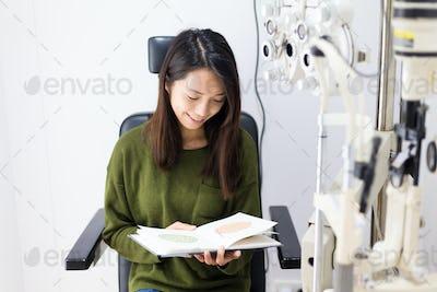 Woman doing color blindness disease
