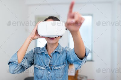 Woman looking with virtual reality device