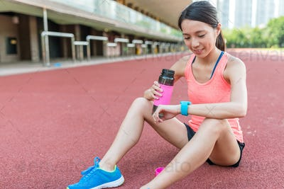 Sport Woman use of smart watch and drink of water