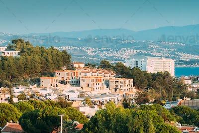Kusadasi, Turkey. Beautiful Cityscape Of Turkish Town. White Residential Houses On Hillside. Real
