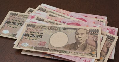 Chinese RMB banknote and Japanese Yen