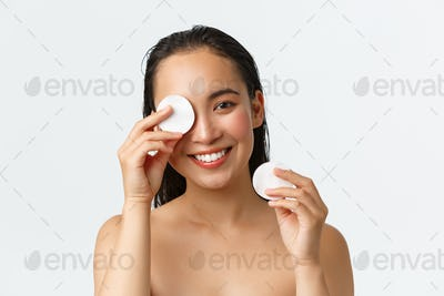 Skincare, women beauty, hygiene and personal care concept. Close-up of attractive naked asian woman