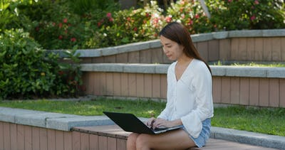 Woman work on laptop at park