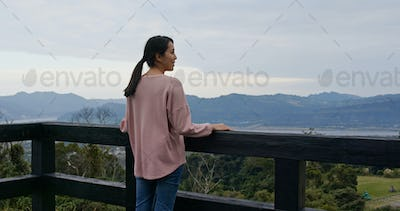 Woman tourist enjoy the view at luye highland in Taitung