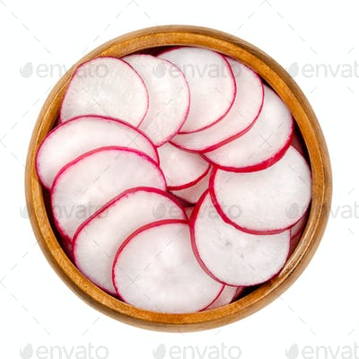 Sliced red radishes in a wooden bowl