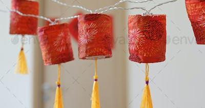 Man giving red packet to woman with the chinese new year decoration at home