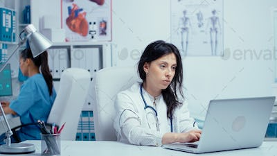 Young woman doctor in private medical cabinet