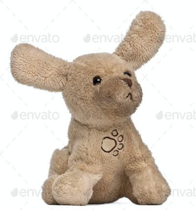 Brown stuffed animal in front of white background