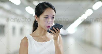 Woman sending audio message on cellphone
