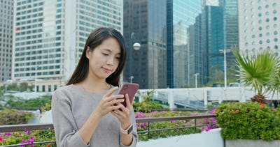 Woman use of smart phone in city of Hong Kong