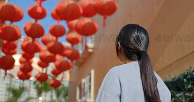Woman look at the red lantern at outdoor