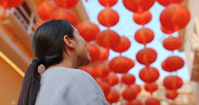 Woman enjoy look at the red lantern