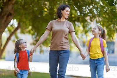 Parent and pupils go to school