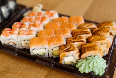 Various kinds of sushi on wood background