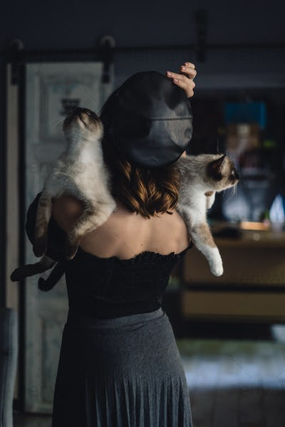 Woman with two siamese cats