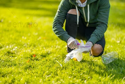 Low section of man cleaning park on sunny day