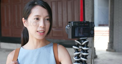 Woman holding camera and visit traditional chinese architecture building and looking around