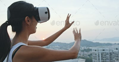 Woman watching with VR on the roof top