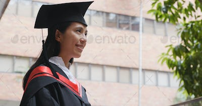 Young woman get graduation and look far away