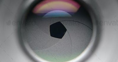 Changing aperture camera lens