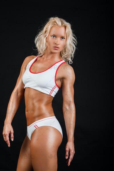 Blond female in a white sexy sportswear.