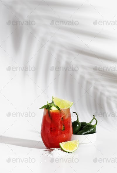 Spicy alcoholic cocktail with vodka, tomato juice, jalapeno pepper, lime and salt