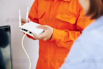 Electrician explaining how to use wi-fi router