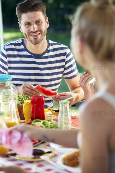 Vertical image of couple spending time on barbecue