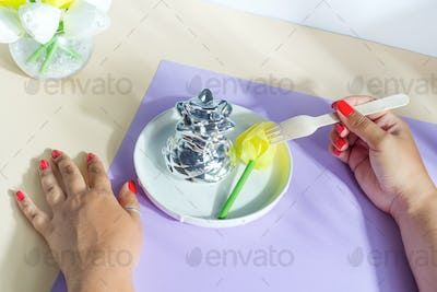Plate served flower and woman's hand with wooden fork