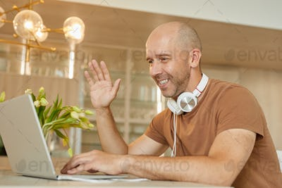 Mature Man Chatting by Video Call at Home