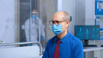 Worried senior patient with a mask