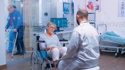 Disabled senior woman in wheelchair seeking medical consultation