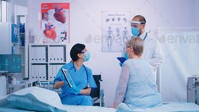 Nurse talking with senior woman