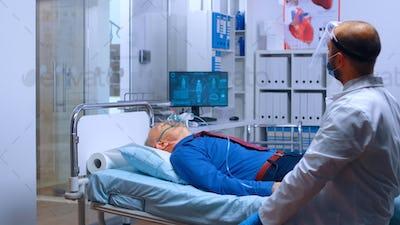 Retired senior man in oxygen mask