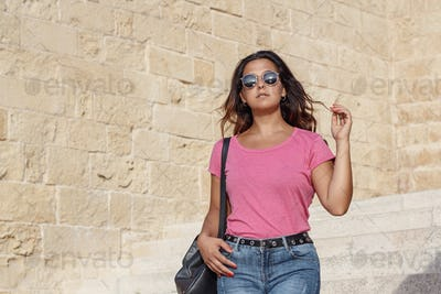 Place it - Young women wearing t-shirt and jeans going down the stairs
