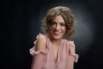 Beatiful curly girl wearing pink dress
