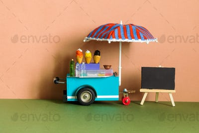 Ice cream toy cart with blue red umbrella.