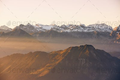 Panorama of snowcapped mountains at sunrise