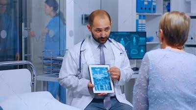 Practitioner doctor showing radiology scan