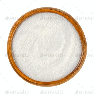 Crystalline citric acid, monohydrate, in a wooden bowl