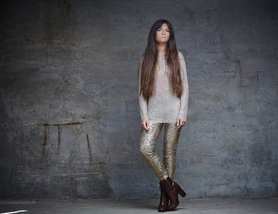 Fashionable woman with long brown hair.