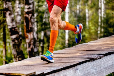 legs man runner in compression socks