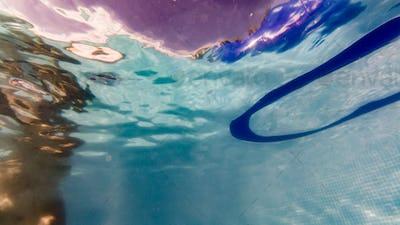 underwater view of people enjoying a swimming pool
