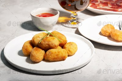 Tapas croquettes, traditional Spanish or French snack. Concrete background