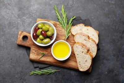 Ripe olives, olive oil and ciabatta bread