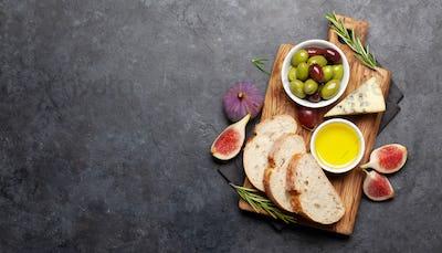 Ripe olives, figs, olive oil and ciabatta bread